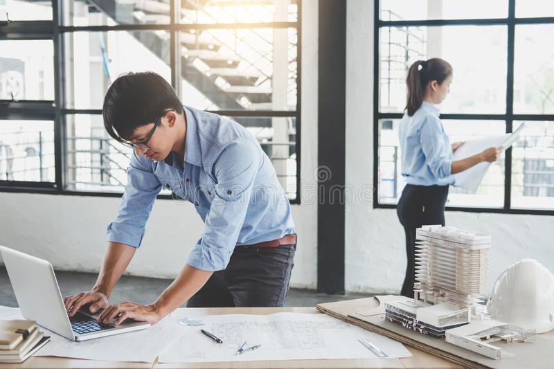 Construction concept of Engineer or architect meeting for project working with partner and engineering tools on model building royalty free stock photos