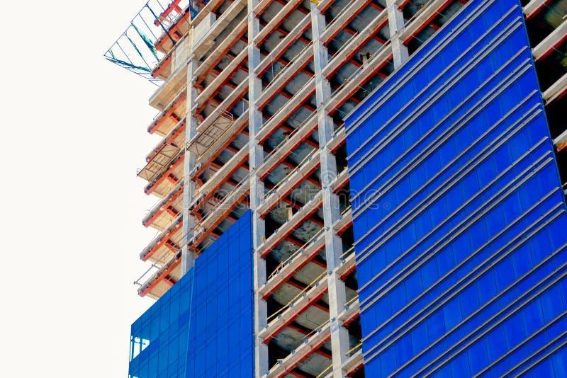 Construction concept. the construction of a tall apartment building. glass blue facade stock photos