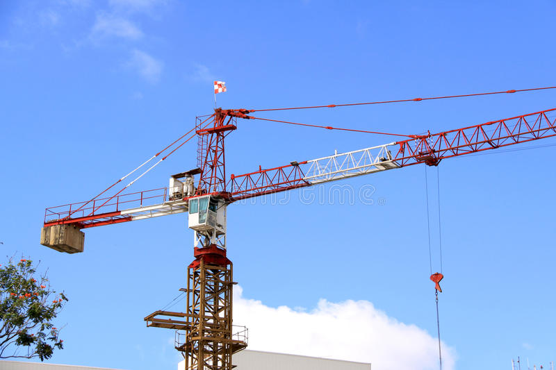 Construction crane. One of the major equipment or lifting device needed to speed up construction process stock images