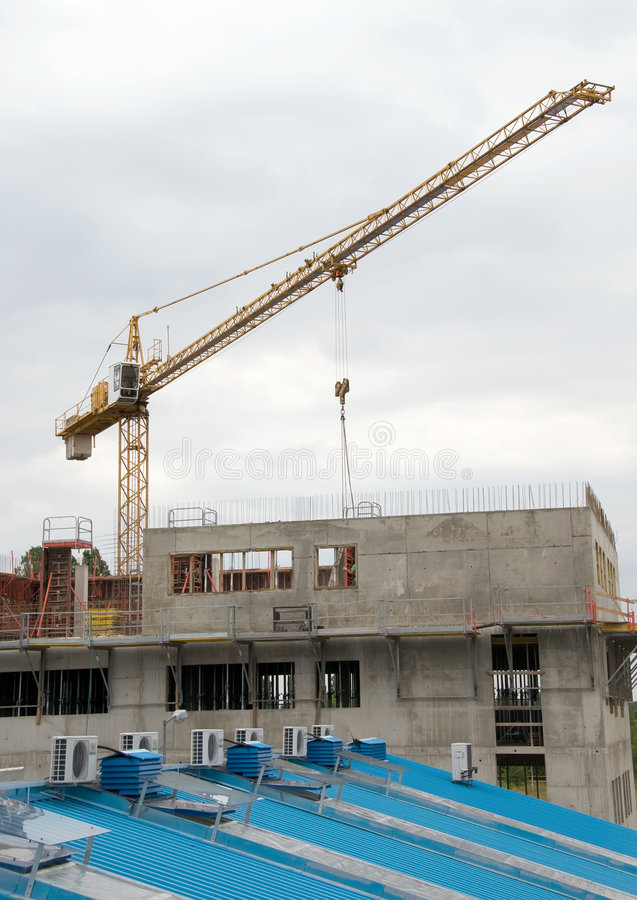 Construction crane. Building new offices with construction crane stock image
