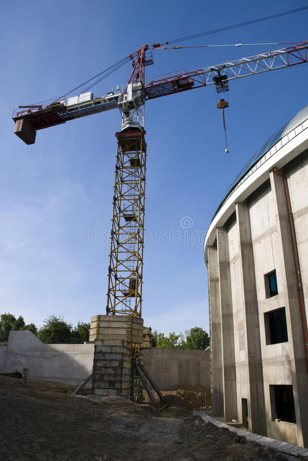Construction and a crane. A construction of a new office building with a crane stock photo