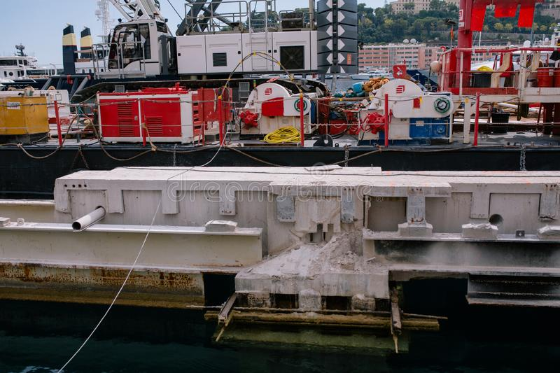 Construction crane afloat in the port of Monaco. Construction crane afloat crane, landscape, water, rescue, ship barge aground calm cargo stock photography