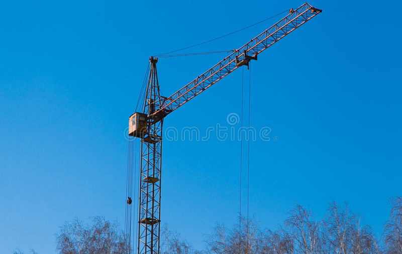 Construction crane. Against blue sky royalty free stock photo