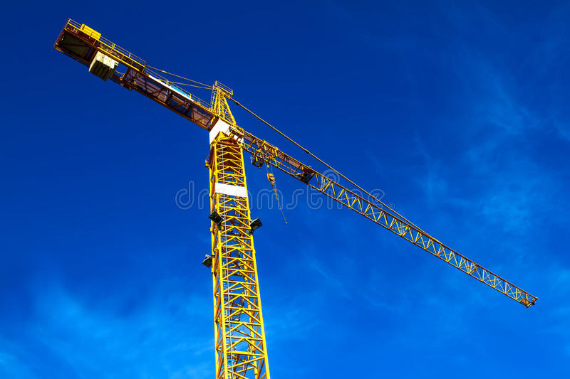 Construction crane. Against a blue sky royalty free stock photo