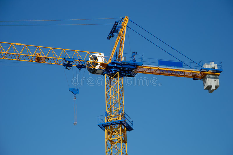 The construction crane against blue sky stock images