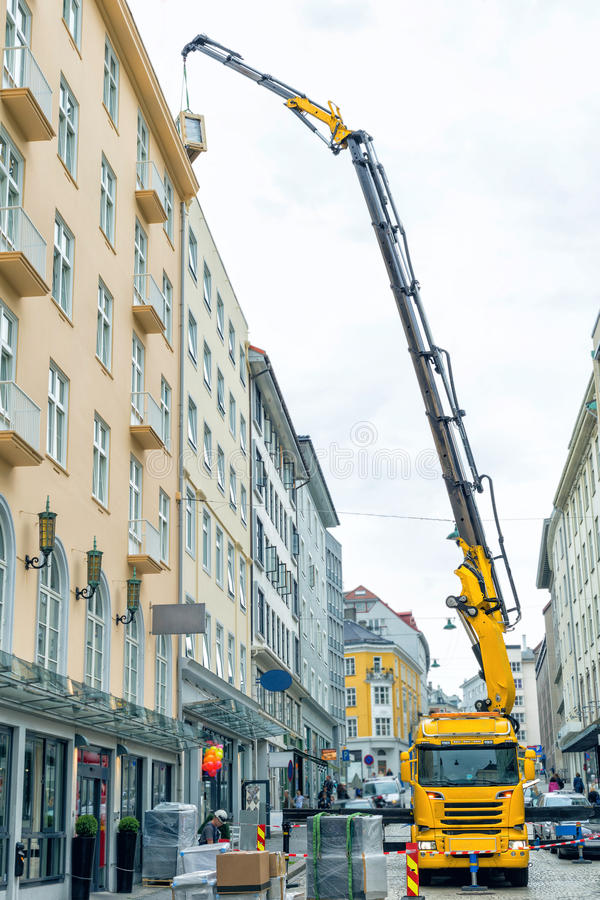 Construction crane in the city. Large construction site including several cranes working on a building complex royalty free stock photos