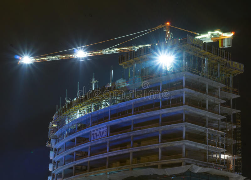 Construction crane in herzlia. That works at night royalty free stock images