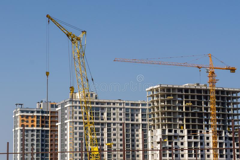 Construction crane and high-rise building under construction royalty free stock image