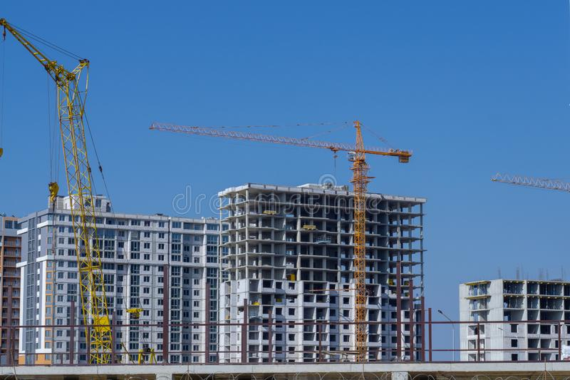 Construction crane and high-rise building under construction stock photography