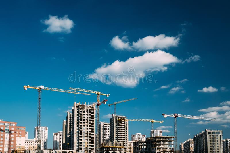 Construction Crane Is Involved In Development Of A New Multi-storey Residential Building.  stock image