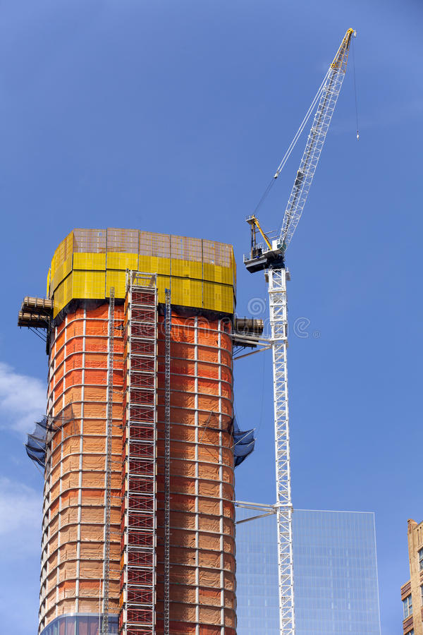 Construction - Crane and new highrise apartment building. In New York City stock images