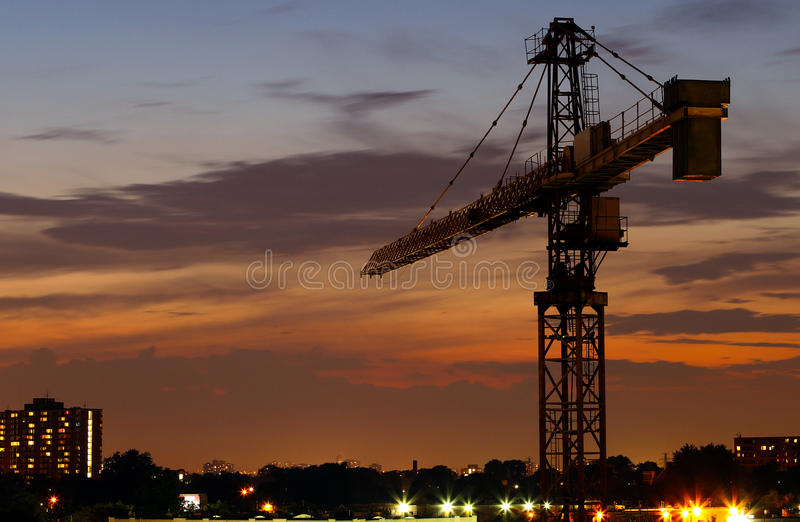 Construction crane at night stock images