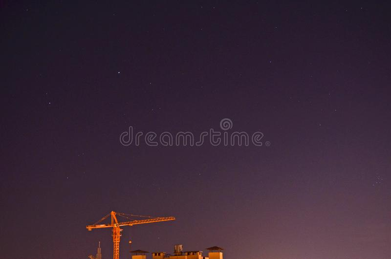 Construction crane in the night sky. stock photography