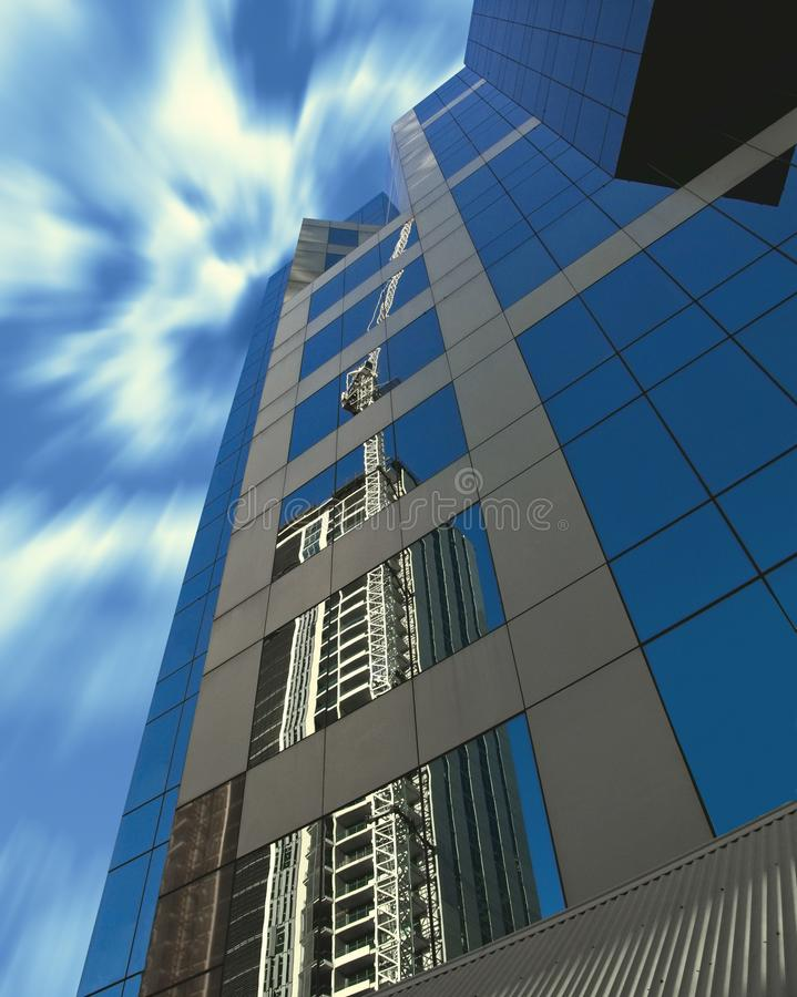 Free Construction Crane Reflected In Modern Building Royalty Free Stock Photography - 116078027