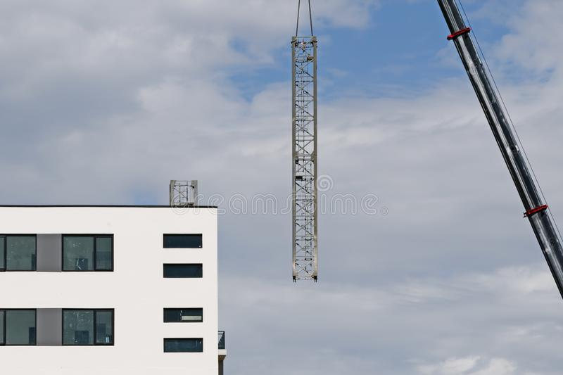 Construction crane removal. Update ed325. Gosford. April 9, 2019. Gosford, New South Wales, Australia - April 9, 2019: The disassembly of a tower crane from new royalty free stock photography