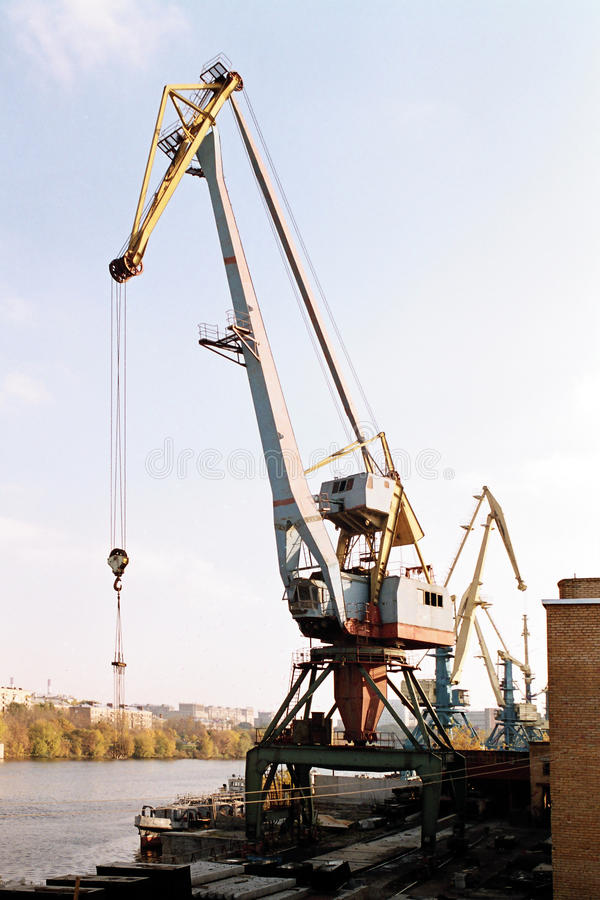 Construction crane on waterfront stock image