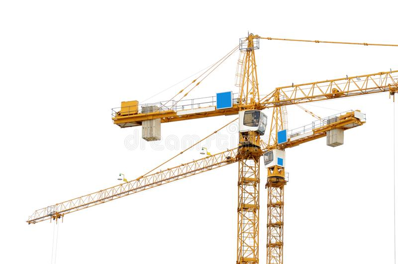 Construction crane on white background. It is used to lift loads at the construction site royalty free stock photography