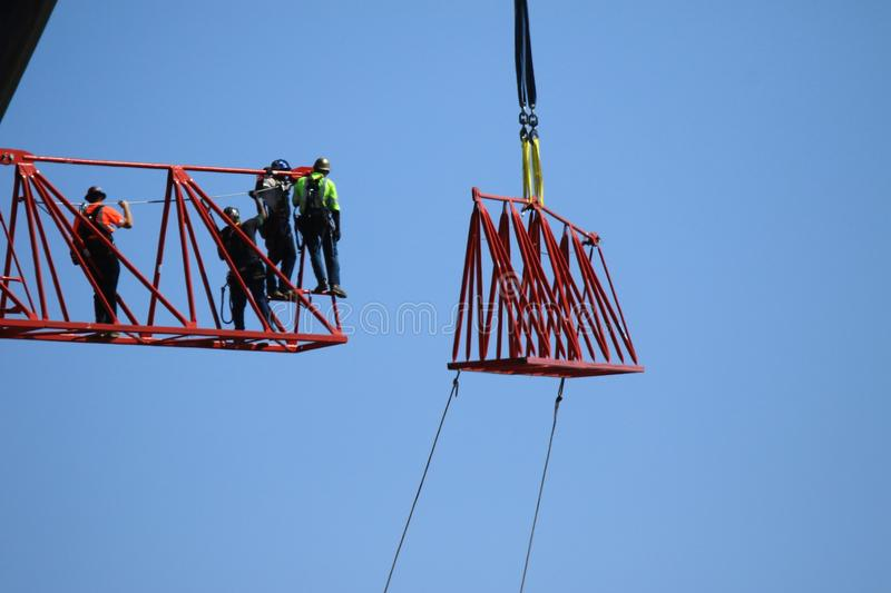 Construction of crane. Workers construct crane in Los Angeles stock photo