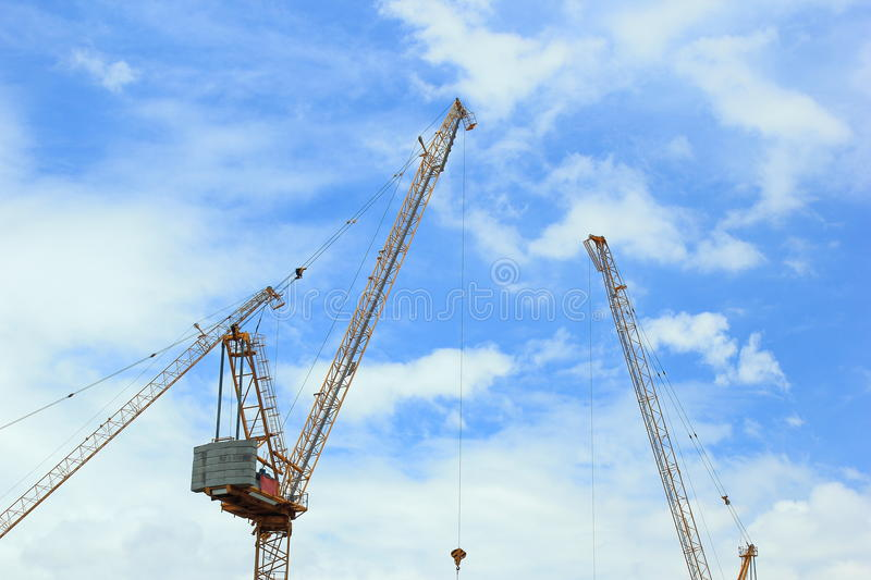 Construction cranes for architectural and engineering work. Background of construction cranes for architectural and engineering work stock photos