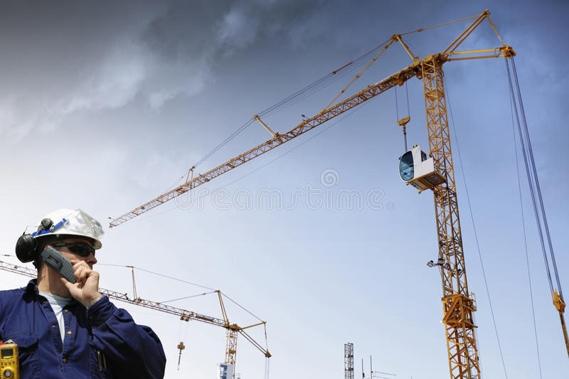 Construction Cranes And Building Worker Royalty Free Stock Image