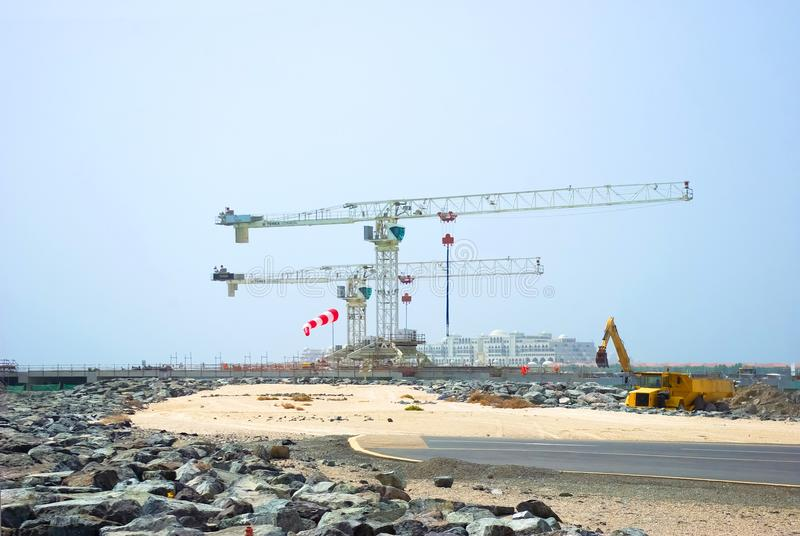 Construction cranes in Dubai stock photos