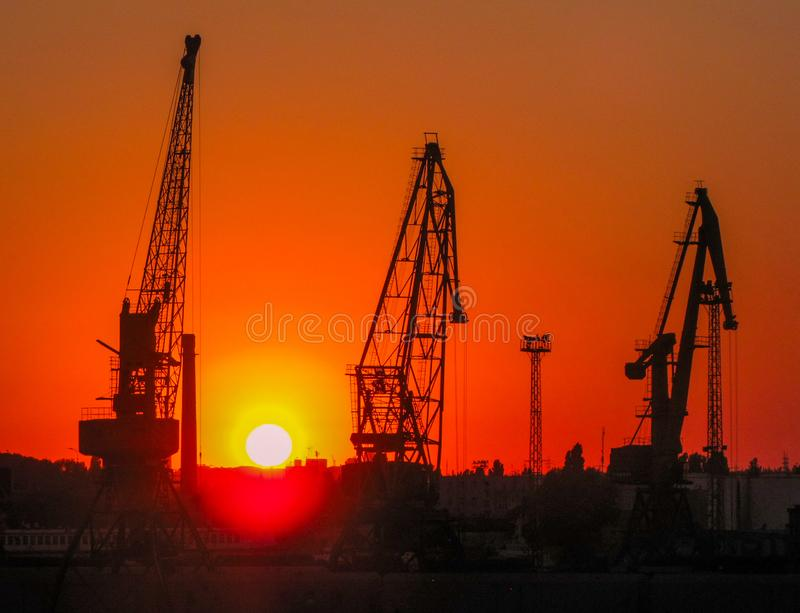 Sunset in Odessa, Ukraine. Construction cranes at sunset in the port of Odessa, Black Sea, Ukraine stock image
