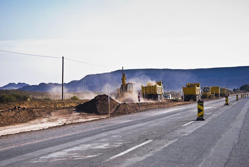 Construction de routes lourde en cours images stock
