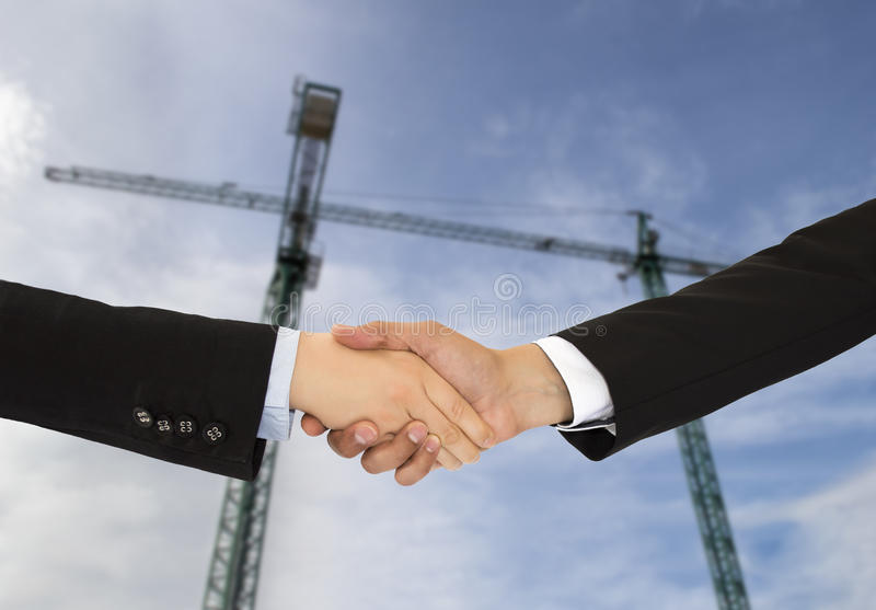 Construction deal. Close up of construction deal with handshake stock images