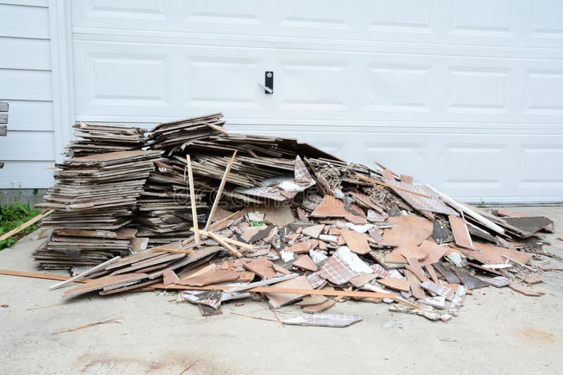 Construction Debris Pile. Construction debris in a pile outside of home remodel with flooring tiles stock photo