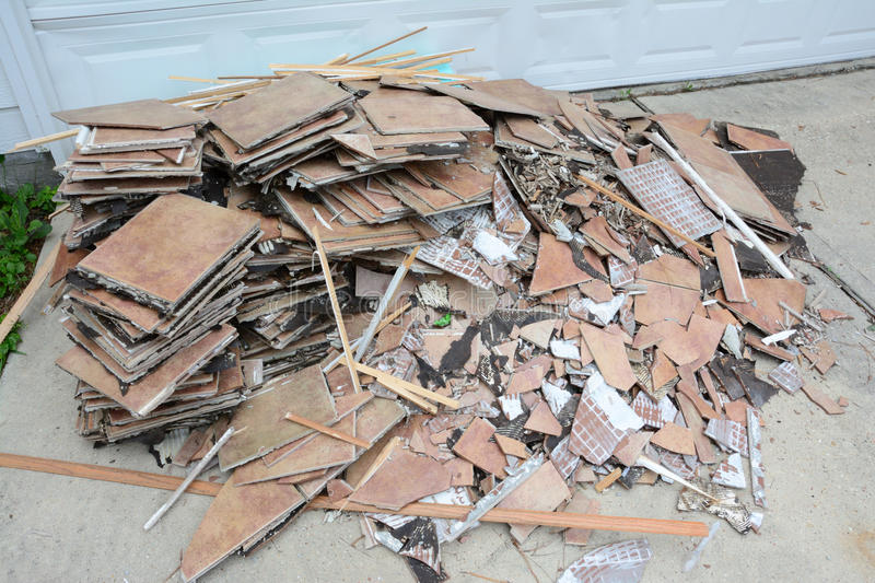 Construction Debris Pile. Construction debris in a pile outside of home remodel with flooring tiles stock image