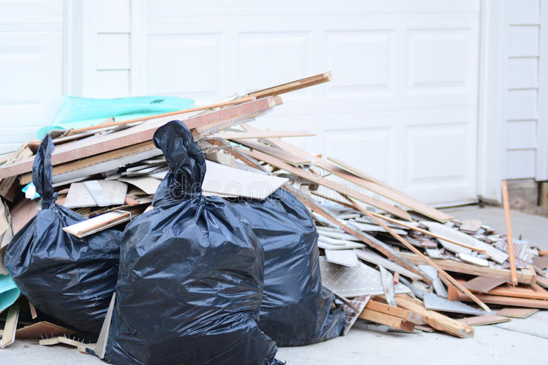Construction Debris Pile. Construction debris in a pile outside of home remodel with flooring tiles royalty free stock photo