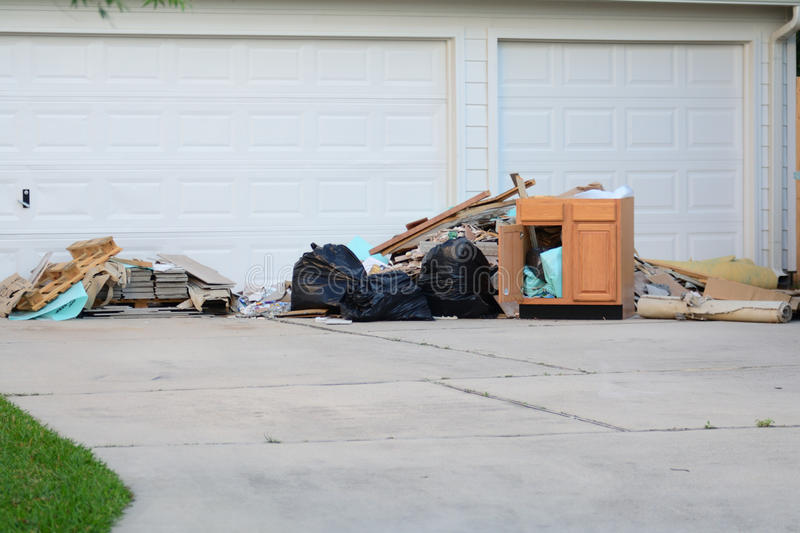 Construction Debris Pile. Construction debris in a pile outside of home remodel with flooring tiles royalty free stock image