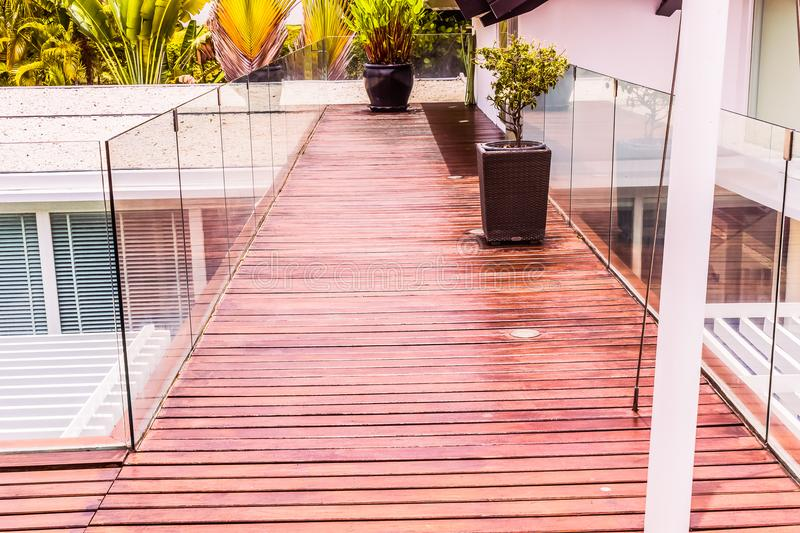 Construction details : Tempered glass balustrades on wooden roof deck royalty free stock image