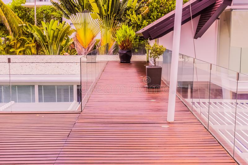Construction details : Tempered glass balustrades on wooden roof deck royalty free stock photo