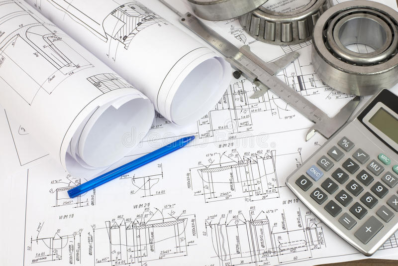 Construction drawings. Desk Engineer stock photos