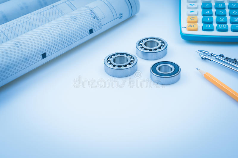 Construction drawings slide caliper roller bearings on blueprint architecture and building concept. royalty free stock photos