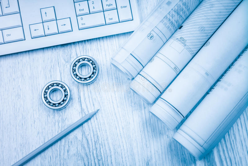 Construction drawings slide caliper roller bearings on blueprint architecture and building concept. royalty free stock photo