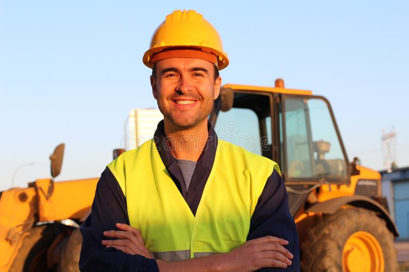 Construction driver with excavator on the background stock images