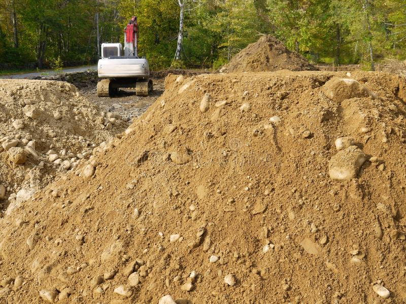Construction: earth piles and backhoe h