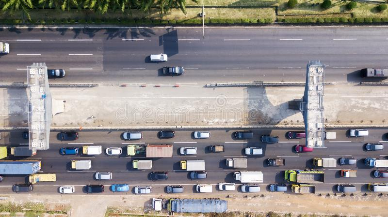 Construction elevated toll road with hectic traffic. West Java, Indonesia - October 10, 2018: Top view of the construction pilings of Jakarta-Cikampek elevated stock images
