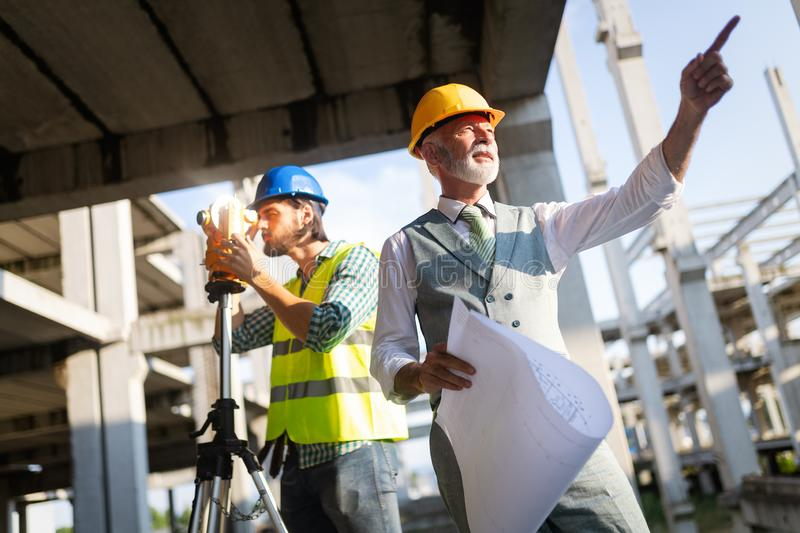 Construction engineer with foreman worker checking construction site royalty free stock photography