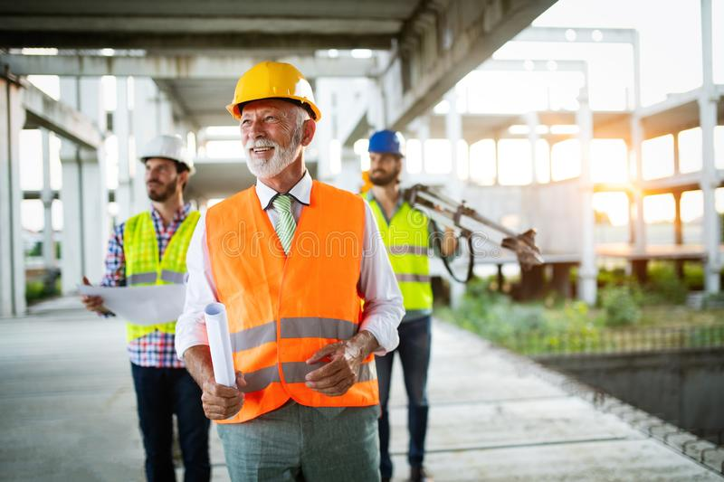 Construction engineer with foreman worker checking construction site stock photos