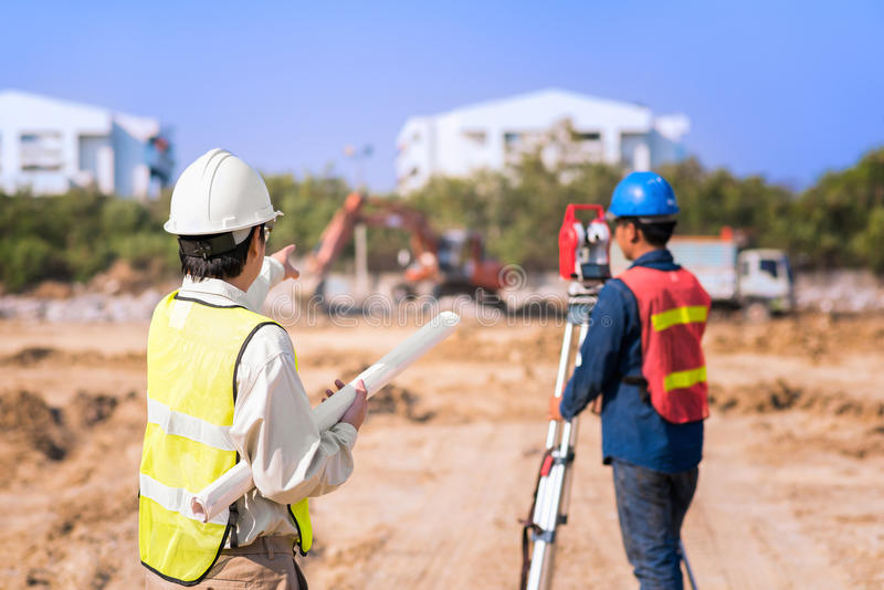 Construction engineer with foreman worker checking site royalty free stock image