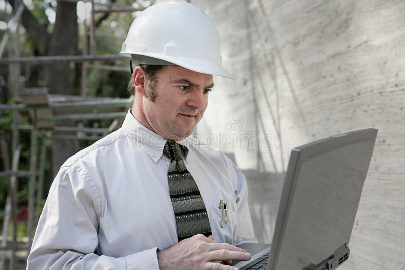 Construction Engineer with Lap stock photos
