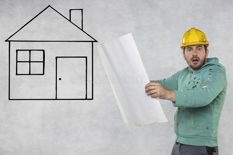 A construction engineer is looking at house plans stock photos