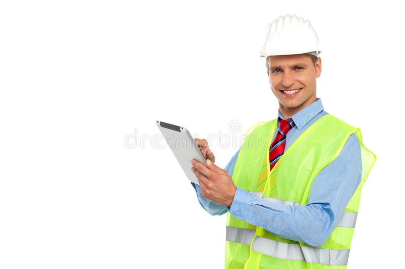 Construction engineer operating wireless device stock image
