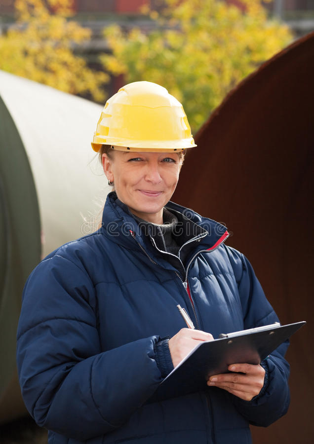 Construction Engineer Takes Notes Stock Photo
