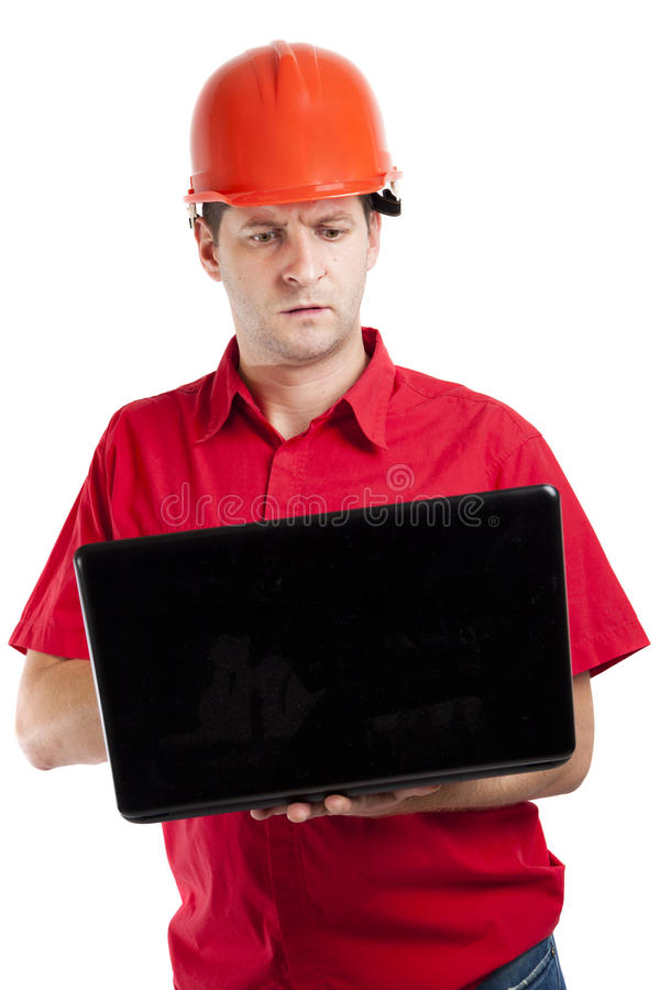Construction engineer using his laptop computer royalty free stock photography