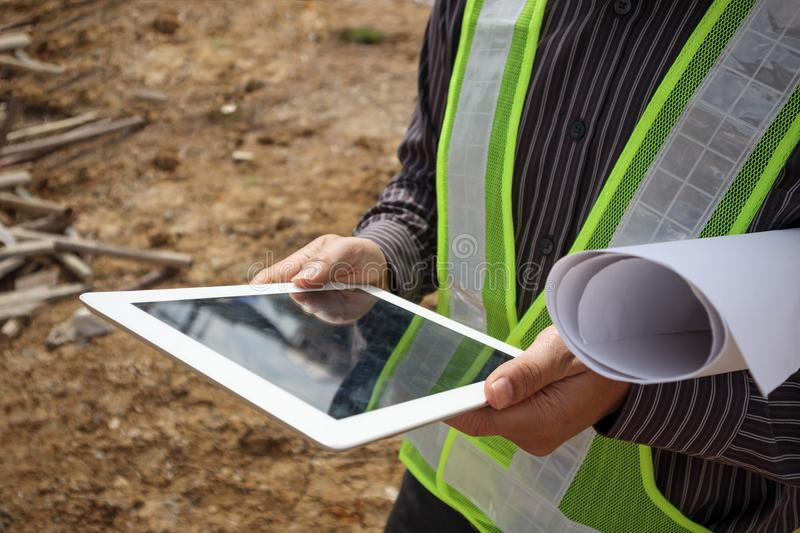 Construction engineer worker using tablet computer stock photos