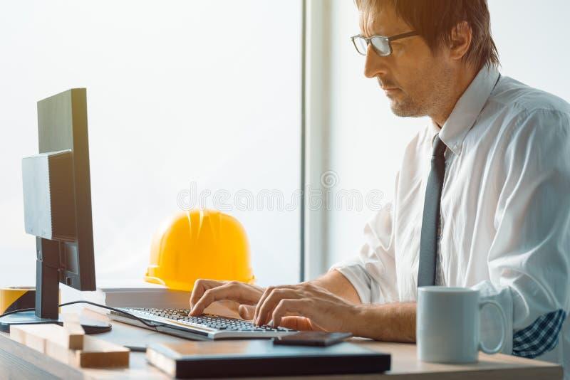 Construction Engineer Working On Desktop Computer Using CAD Soft ...